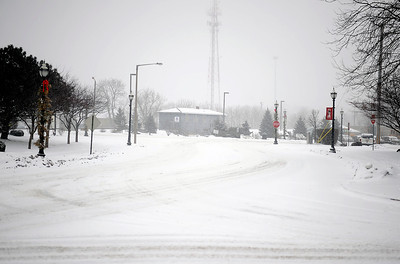 Sarah Nader - snader@shawmedia.com A desolate Downtown Crystal Lake during Friday's snowstorm on January 20, 2012.
