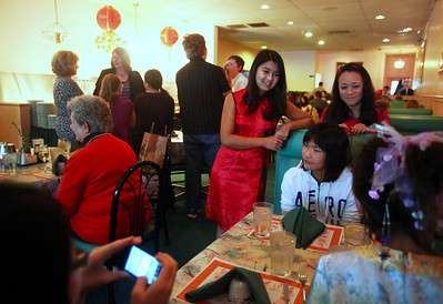 Lauren M. Anderson - landerson@shawmedia.com Mallory Bellairs of Woodstock (left) talks with other adopted Chinese including (from second left) Lian Pankow, 15, Sarah Cornell, 11, and Mei Cornell, 8 all of Woodtock, on Sunday at the Green Garden in Woodstock. The girls were at the restaurant celebrating the Chinese new year.