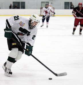 JEFF KRAGE/FOR THE NORTHWEST HERALD Crystal Lake South's and Central all-star Jake Bigos skates into the zone during Sunday's Chicago Metropolitan High School Hockey League All-Star game at the West Meadows Ice Arena.  Rolling Meadows 1/22/12