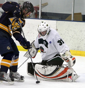 JEFF KRAGE/FOR THE NORTHWEST HERALD Crystal Lake South's and Central all-star goalie Adam Wiese makes a save during Sunday's Chicago Metropolitan High School Hockey League All-Star game at the West Meadows Ice Arena.  Rolling Meadows 1/22/12