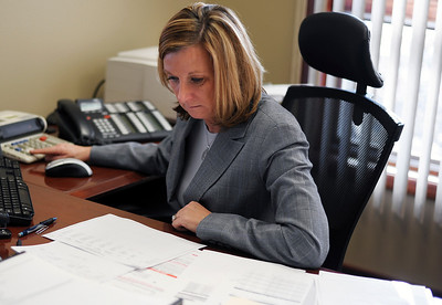 Sarah Nader - snader@shawmedia.com Administrative assistant Janice Eder works at Eder, Casella and Co. in McHenry on Tuesday, January 24, 2012. Eder, Casella and Co. is the biggest accounting firm in the county and announced on Tuesday a merger with another accounting firm.