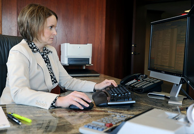 Sarah Nader - snader@shawmedia.com Partner at Eder, Casella and Co. Shelly Casella works in her office on Tuesday, January 24, 2012 in McHenry. Eder, Casella and Co. is the biggest accounting firm in the county and announced on Tuesday a merger with another accounting firm.