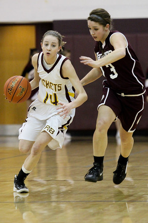Lauren M. Anderson - landerson@shawmedia.com Marengo's Sabrina Marsh (right) runs down court with Richmond-Burton's Erin Thomas during the first quarter on Tuesday. The Rockets defeated the Indians 47-36 in their BNC-East match up.