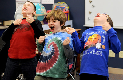 "Sarah Nader - snader@shawmedia.com Anthony Daugherty (left), 9, Samuel Jones, 9, and Lucas Toussaint, 8, all of Johnsburg, act out a poem during a workshop in their third grade classroom where poet, performer, teacher and founder of ""A Child's Voice"" Bill Buczinsky taught the students about poetry at James C. Bush Elementary in Johnsburg on Tuesday, January 24, 2012."