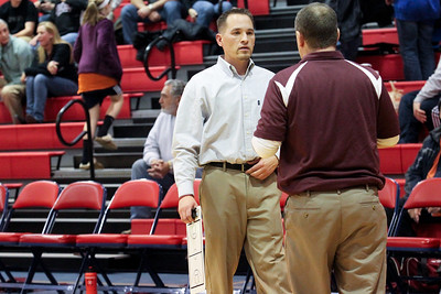 Lauren M. Anderson - landerson@shawmedia.com New Prairie Ridge girls basketball coach Jeff Boldog (left) talks with new assistant coach Rob Baker (right) on Thursday before breaking for half-time against Dundee-Crown.
