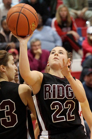 Lauren M. Anderson - landerson@shawmedia.com Prairie Ridge's Haleigh Danek (22) puts up a shot in the first quarter on Wednesday during a game against Dundee-Crown.