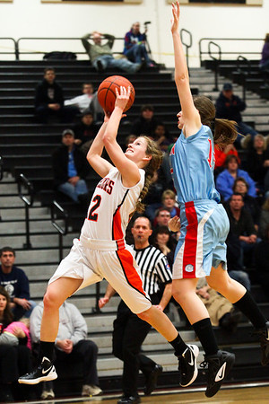 Lauren M. Anderson - landerson@shawmedia.com McHenry's Emma Romme jumps to put up a shot against Marian Central's Ellen Koscienlniak (right) during the second quarter on Thursday. The Warriors defeated the Hurricanes 61-47.