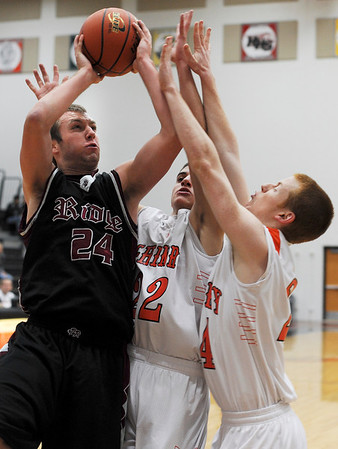 Sarah Nader - snader@shawmedia.com McHenry's Jeff Nichoils (right) and Korey Partenheimer guard Prairie Ridge's Sean Valentine during the second quarter of Friday's FVC Valley matchup in McHenry on January 27, 2012. McHenry won, 56-49.