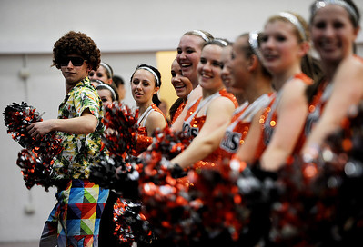 Sarah Nader - snader@shawmedia.com Matt Pawula, 18, of McHenry dances with the McHenry's pom pom team  during Friday's FVC Valley matchup against Prairie Ridge on January 27, 2012. McHenry won, 56-49.
