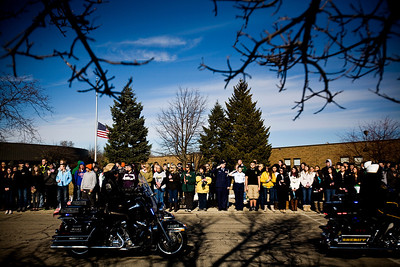 Lance Booth - lbooth@shawmedia.com Police escorts pass in front of Crystal Lake South escorting Marine Capt. Nathan McHone, whose body was returned to Crystal Lake today. McHone was killed in a helicopter crash in Afghanistan and was a 2011 graduate of South.