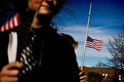 Lance Booth - lbooth@shawmedia.com The flag in front of Crystal Lake South hung at half-staff in support of Marine Capt. Nathan McHone, whose body was returned to Crystal Lake today. McHone was killed in a helicopter crash in Afghanistan and was a 2011 graduate of South.