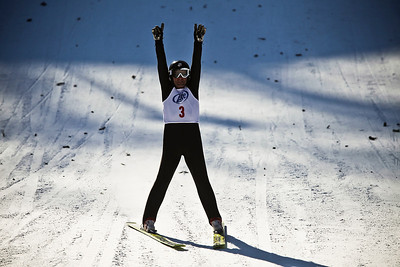 Lance Booth - lbooth@shawmedia.com A skier celebrates after landing during the 107th annual Norge Ski Jump Championship on Sunday, January 29, 2012.