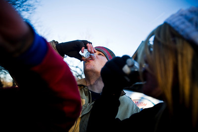 Lance Booth - lbooth@shawmedia.com Vince Gillis, of Cary, takes a shot of Jägermeister at the 107th annual Norge Ski Jump Championship on Sunday, January 29, 2012.