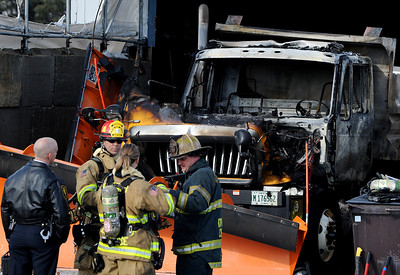 Sarah Nader - snader@shawmedia.com Firefighters put out a shed fire Monday afternoon at Dunham Twp Highway Dept in Harvard on January 30, 2012. The fire destroyed a plow truck that was in the shed.
