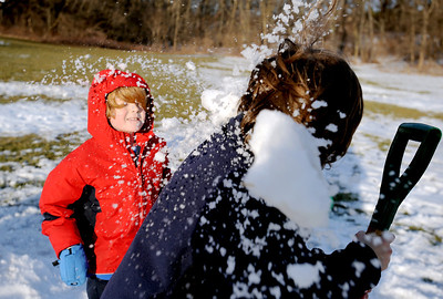Sarah Nader - snader@shawmedia.com Tommy Hannan (left), 7, of Island Lake throws a snowball at Keifer Besterfeldt, 8, of Crystal Lake while playing the the last remaining snow at Veteran Acres Park in Crystal Lake on Monday, January 30, 2012. Tuesday's temperature is suppose to be unusually high at around 50 degrees.