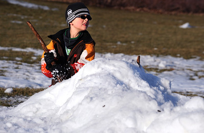 Sarah Nader - snader@shawmedia.com Brandon Horning, 8, of McHenry builds a fort with the last remaining snow at Veteran Acres Park in Crystal Lake on Monday, January 30, 2012. Tuesday's temperature is suppose to be unusually high at around 50 degrees.