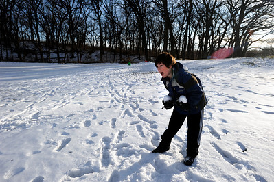 Sarah Nader - snader@shawmedia.com Garett Besterfeldt, 10, of Crystal Lake is ready to attack while having a snowball fight with the last remaining snow at Veteran Acres Park in Crystal Lake on Monday, January 30, 2012. Tuesday's temperature is suppose to be unusually high at around 50 degrees.