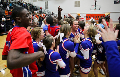 Jenny Kane - jkane@shawmedia.com Tues. Jan. 31, 2012 Dundee-Crown players, cheerleaders and fans rush McHenry's floor after defeating them in the final minutes of their game 51-49.