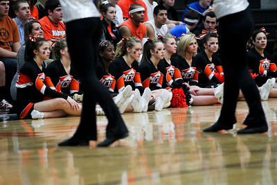 Jenny Kane - jkane@shawmedia.com Tues. Jan. 31, 2012 McHenry cheerleaders and fans watch as McHenry's drill team takes the floor for their half-time routine.