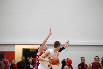 Jenny Kane - jkane@shawmedia.com Tues. Jan. 31, 2012 Dundee-Crown's Dylan Kissack tries to block McHenry's Jamie Rammel from making a pass during the final minutes of their game. Dundee-Crown defeated McHenry 51-49 at McHenry.