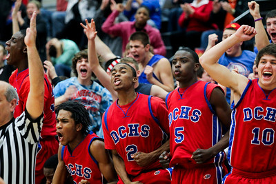 Jenny Kane - jkane@shawmedia.com Tues. Jan. 31, 2012 Dundee-Crown's bench cheers after a three point shot by Will Stupar to take the lead in the final minutes of their game against McHenry. Dundee-Crown defeated McHenry 51-49 at McHenry.