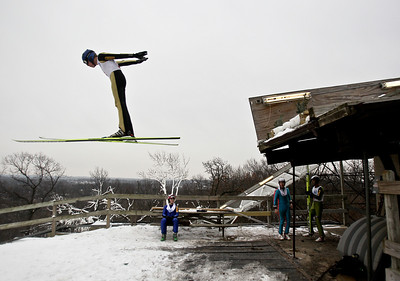 Josh Peckler - Jpeckler@shawmedia.com Ryan Johnson flies off the ramp while performing his jump during the Norge International Ski Jumping Tournament at the Norge Ski Club in Fox River Grove Sunday, January 27, 2013.