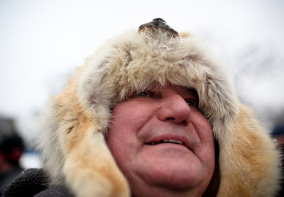 Josh Peckler - Jpeckler@shawmedia.com Stanley Michaels of Mchenry used a coyote skin hat to keep warm as he watched skier jump during the Norge International Ski Jumping Tournament at the Norge Ski Club in Fox River Grove Sunday, January 27, 2013.