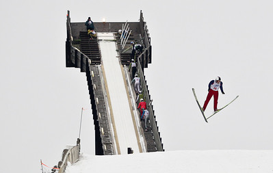 Josh Peckler - Jpeckler@shawmedia.com Luke Daniels flies through the air as he ski jumps during the Norge International Ski Jumping Tournament at the Norge Ski Club in Fox River Grove Sunday, January 27, 2013.