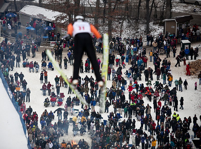 Josh Peckler - Jpeckler@shawmedia.com Hundreds of people watch as Matthew Doyle performs his jump during the Norge International Ski Jumping Tournament at the Norge Ski Club in Fox River Grove Sunday, January 27, 2013.