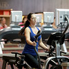 Tiffany Klem of Batavia works out on an elliptical machine at XSport Fitness in Batavia.
