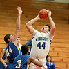 Connor Chapman (44) of Geneva goes up for a shot during their 73-48 win over Aurora Central Catholic in the East Aurora Holiday Tournament Friday.