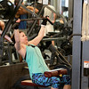 Anne Quinlan, visiting from Minnesota, works out on the weight machines at XSport Fitness in Batavia.