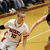 Jeff Krage – For the Kane County Chronicle<br /> Batavia's Mike Rueffer drives toward the basket around Centennial's Devin Prado during Saturday's game at the 38th annual Elgin Holiday Basketball Tournament.<br /> Elgin 12/29/12
