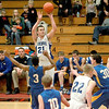 Geneva's Mike Trimble goes up for a shot during their 73-48 win over Aurora Central Catholic in the East Aurora Holiday Tournament Friday.