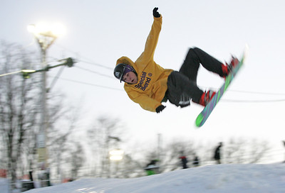 Monica Maschak - mmaschak@shawmedia.com Derek Larsen, 20, prepares to land from a frontside rodeo flip off of a jump at the Raging Buffalo Snowboard and Ski Park in Algonquin on Wednesday, January 2, 2013. The park offers equipment rentals as well as group and private snowboarding lessons.
