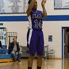 Plano's Tachae Miles shoots a three pointer against Rosary at Rosary in Aurora, IL on Friday, January 04, 2013 (Sean King for The Kane County Chronicle)