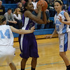 Plano's Tachae Miles (14) takes the ball to the hoop past Rosary's Megan Conlin (14) and Quincy Kellett (10)<br /> at Rosary in Aurora, IL on Friday, January 04, 2013 (Sean King for The Kane County Chronicle)