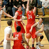 Kaneland's Dan Miller passes the ball around Yorkville defenders during their game Friday night.