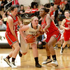 Kaneland's Ashley Prost tries to get past a pair of Yorkville defenders during the Knights' 26-39 loss Friday night.