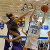 Rosary's Karly Tate (13) goes up for a layup against Plano<br /> at Rosary in Aurora, IL on Friday, January 04, 2013 (Sean King for The Kane County Chronicle)