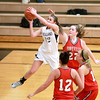 Kaneland's Emma Bradford goes up for a shot during their 26-39 loss to Yorkville Friday night.