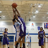 Plano's Tachae Miles (14) pulls down a rebound against Rosary at Rosary in Aurora, IL on Friday, January 04, 2013 (Sean King for The Kane County Chronicle)