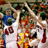 Geneva's Connor Chapman passes the ball around Batavia's Mike Carlson (40) and Jake Pollack (3) during their game at Batavia Friday night.