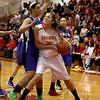 Hannah Frazier of Batavia tries to get past Geneva's Sidney Santos during their game at Batavia Friday night.