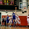 Micah Coffey (14) of Batavia tries to block a shot by Geneva's Jason D'Amico during their game at Batavia Friday night.
