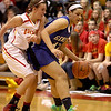 Geneva's Sidney Santos tries to get past Lize Fruendt of Batavia during their game at Batavia Friday night.