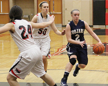 Don Lansu for the Northwest Herald.Katie Barker, Cary-Grove forward  (2) dribbles thru the Huntley defenders Ali Andrews (50) and Bethany Zornow (24) during varsity action at Huntley H.S. 1/12/2012.