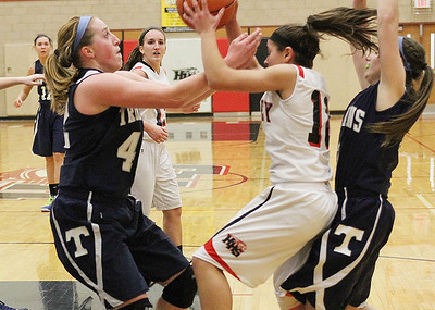Don Lansu for the Northwest Herald.Huntley guard Kayla Barreto (10) fights for the rebound against Cary-Grove defenders Samantha Andrews (40) and Amanda Kaniewski during varsity action at Huntley H.S. 1/12/2012.