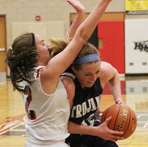 Don Lansu for the Northwest Herald.Cary-Grove's Olivia Jakubicek (42)  won't be denied as she drives the paint against Huntley's Haley Ream (12)  during action at Huntley H.S. 1/12/2012.