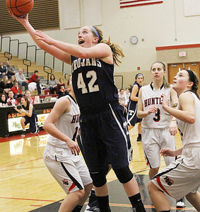 Don Lansu for the Northwest Herald.Cary-Grove forward Olivia Jakubicek (42) goes for the layup as Huntley's Samantha Andrews (40) positions for the rebound during action at Huntley 1/12/2012.